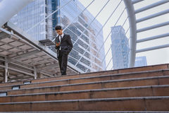 Businessman using a cell phone and modern office building backgr. Businessman using a cell phone  and modern office building background Royalty Free Stock Photography