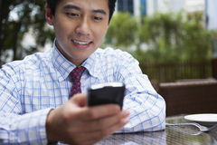 Businessman Using Cell Phone At Outdoor Cafe Royalty Free Stock Photos