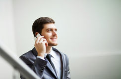 Businessman using a cell phone Stock Image
