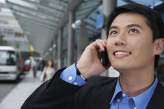 Businessman Using Cell Phone On Street Stock Photo