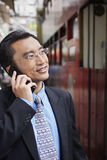 Businessman Using Cell Phone On Street Royalty Free Stock Images