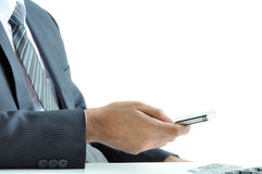 Businessman using cell phone Stock Images