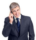 Businessman using a cellphone against white Stock Photography