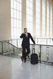 Businessman Using Cellphone In Airport Royalty Free Stock Image