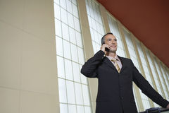 Businessman Using Cellphone In Airport Royalty Free Stock Photos