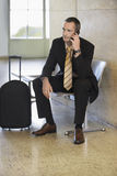 Businessman Using Cellphone In Airport Stock Photos