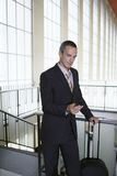 Businessman Using Cellphone In Airport Stock Photography