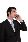 Businessman using a cellphone Stock Photos