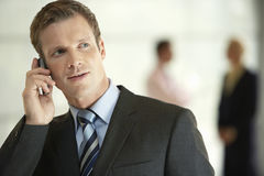 Businessman Using Cellphone In Office Royalty Free Stock Images