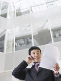 Businessman Using Cellphone In Office Royalty Free Stock Image