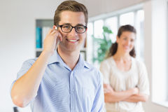 Businessman using cellphone in office Stock Photo
