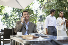 Businessman Using Cellphone At Outdoor Cafe Royalty Free Stock Photo