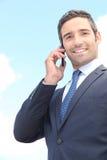 Businessman using a cellphone Stock Photos