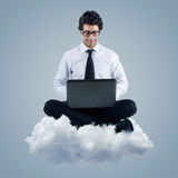 Businessman using cloud computing technology. Young businessman using cloud computing technology Royalty Free Stock Photography