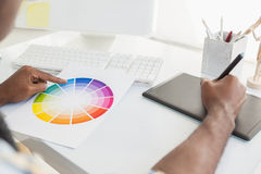 Businessman using colour sample and digitizer Stock Image