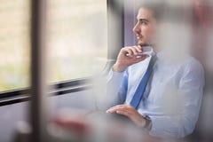 Businessman using commuter rail Stock Photos