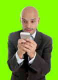 Businessman using compulsively cell phone smiling in mobile addiction isolated green chroma key. Happy young friendly businessman using compulsively cell phone Royalty Free Stock Photo