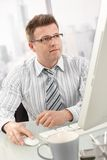 Businessman using computer Stock Images