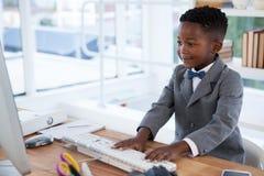 Businessman using computer at desk Royalty Free Stock Photos