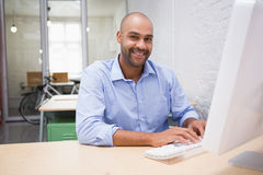 Businessman using computer at desk Stock Photography