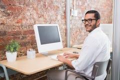 Businessman using computer at desk Stock Image