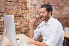 Businessman using computer at desk Royalty Free Stock Image
