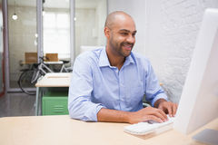 Businessman using computer at desk Royalty Free Stock Photo
