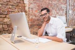 Businessman using computer at desk Stock Photos