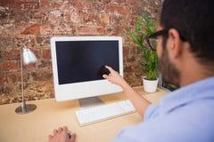 Businessman using computer at desk Stock Images
