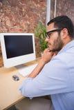 Businessman using computer at desk Stock Photo