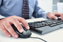 Businessman using computer with hands typing on a keyboard Royalty Free Stock Photos