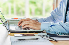 Businessman using computer laptop Financial Report Revenue Stati Royalty Free Stock Images