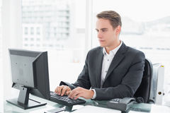 Businessman using computer at office desk Stock Photo