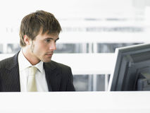 Businessman Using Computer In Office Stock Image