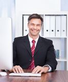 Businessman using computer Stock Image