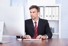 Businessman using computer Royalty Free Stock Images