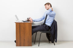 Businessman Using Computer Suffering From Neck Royalty Free Stock Photos