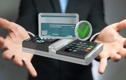 Businessman using contactless terminal payment 3D rendering. Businessman on blurred background using contactless terminal payment 3D rendering Royalty Free Stock Photos