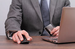 Businessman is using credit card for on line payment close up Royalty Free Stock Photos