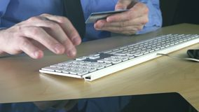 Businessman using credit card for online transaction stock video footage