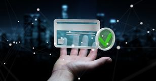 Businessman using credit card to pay online 3D rendering. Businessman on blurred background using credit card to pay online 3D rendering Royalty Free Stock Image