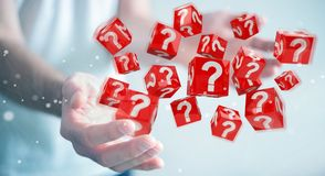 Businessman using cubes with 3D rendering question marks. Businessman on blurred background using cubes with 3D rendering question marks Stock Images