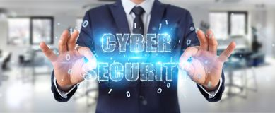 Businessman using cyber security text hologram 3D rendering. Businessman on blurred background using cyber security text hologram 3D rendering Royalty Free Stock Photography