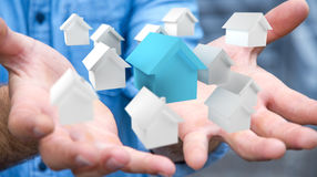 Businessman using 3D rendered small white and blue houses Royalty Free Stock Image
