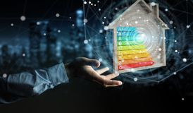 Businessman using 3D rendering energy rating chart in a wooden h. Businessman on blurred background using 3D rendering energy rating chart in a wooden house Royalty Free Stock Image