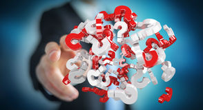 Businessman using 3D rendering question marks. Businessman on blurred background using 3D rendering question marks Stock Photos