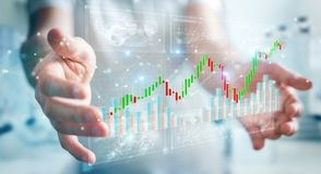 Businessman using 3D rendering stock exchange datas and charts. Businessman on blurred background using 3D rendering stock exchange datas and charts Royalty Free Stock Images