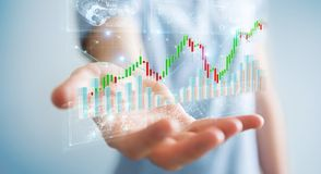 Businessman using 3D rendering stock exchange datas and charts. Businessman on blurred background using 3D rendering stock exchange datas and charts Stock Photo