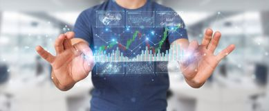Businessman using 3D rendering stock exchange datas and charts. Businessman on blurred background using 3D rendering stock exchange datas and charts Royalty Free Stock Photo