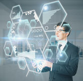 Businessman using device with charts. Man using device with abstract honeycomb chart and diagram hologram. Business technology concept stock illustration